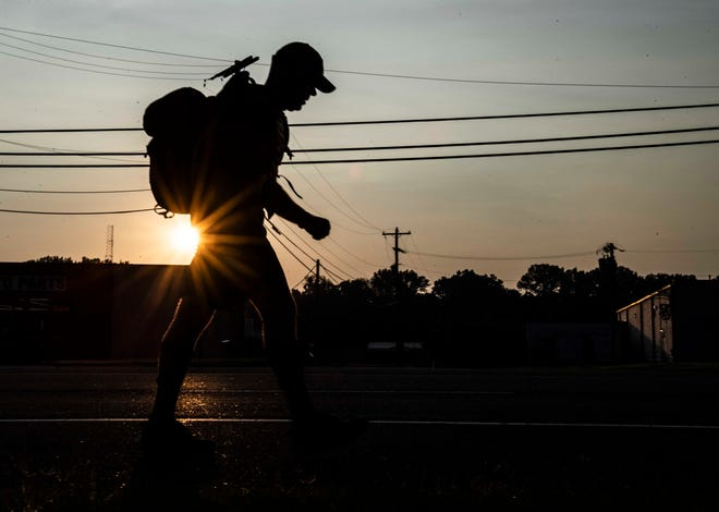 Chief Julian Wiser wakes up at 3 a.m. to take a walk from the police station, down South Highland Ave in Jackson, Tenn., Wednesday, Sept. 9, 2020. Chief Wiser's goal is to walk 360 miles in the month of September to raise awareness of the suicide rate for Veterans . Each day he aims to walk 12 to 16 miles.