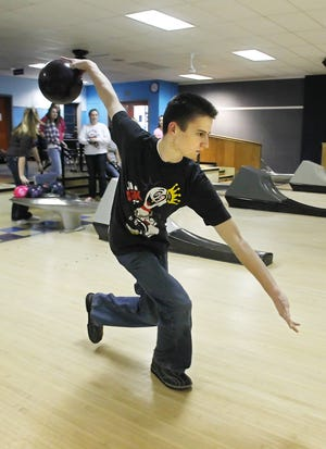 In this 2011 photo, Zach Rhoades and his Harrison High School teammates practiced at Star Lanes.