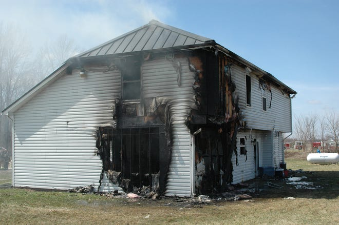 This investigators' photo shows Brandon Abbott's rented house in the 10700 block of Brandy Kay Court, where Abbott's twin sons died April 5, 2014. Prosecutors believe the fire started  when a propane tank ruptured. Prosecutors believe Abbott used the propane tank to fuel a blow torch to create dab, a concentrated wax made from marijuana. Abbott pleaded guilty in March 2015 to neglect of a dependent resulting in death, but his case was reinstated after he won a post-conviction relief and the convictions were vacated.