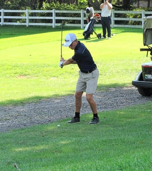 Lancaster junior Isaac Reif hits a chip shot during Tuesday's Lancaster Invitational at the Lancaster Country Club. 15 team participated in the invitational.