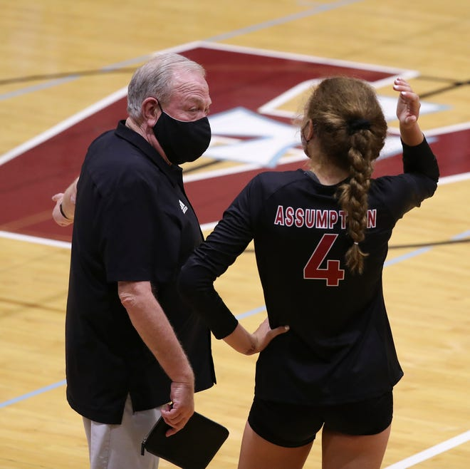 Assumption head coach Ron Kordes instructed Sydney Helmers (4) during their match against Mercy at Assumption High School Louisville, Ky. on Sept. 8, 2020.