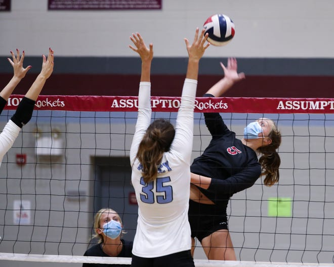 Assumption's Emily Ready (5) returns against Mercy during their match at Assumption High School Louisville, Ky. on Sept. 8, 2020.