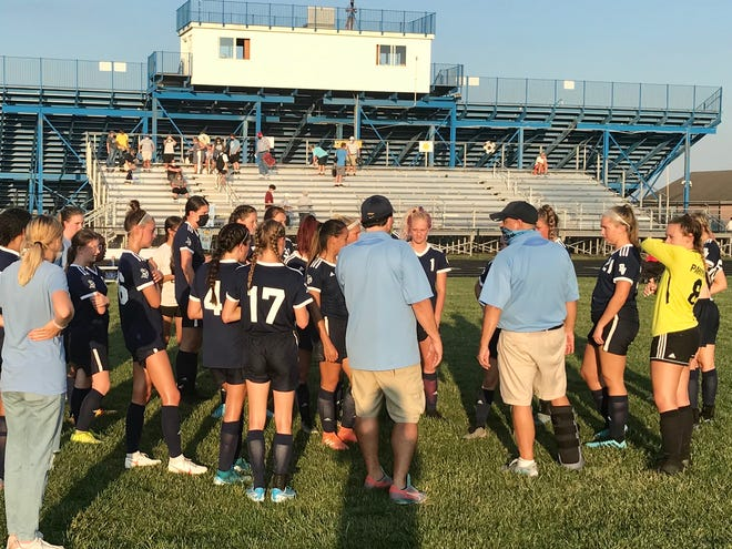 River Valley girls soccer coach Justin Hage and and assistant Joel Richards speak to the team after a 2-0 win over Highland earlier this season. Due to 15 players needing to quarantine due to the coronavirus, RV cannot play in Saturday's sectional tournament game at Jonathan Alder.