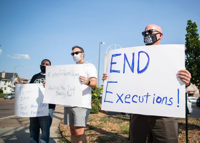 Demonstrators Peter Fathje, Tom Fuerst and Darell Harrington participate in a rally on Union Avenue for death row inmate Pervis Payne in Memphis, Tenn., on Wednesday, September 9, 2020. Payne is scheduled to be executed by lethal injection on Dec. 3,
