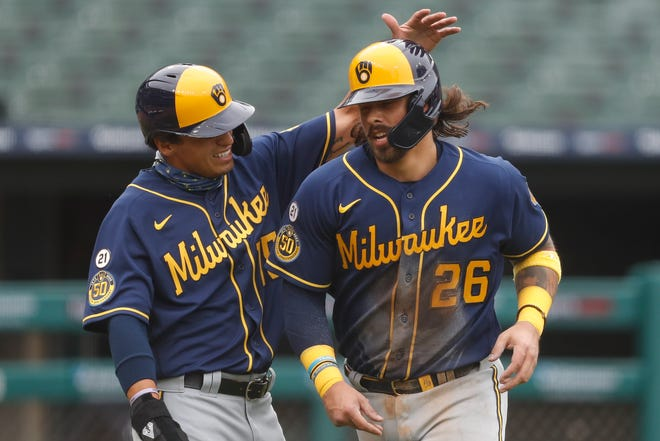 Catcher Jacob Nottingham, right, started 16 games for the Brewers last season before injuring his thumb in the playoffs.