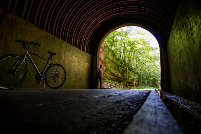 The Elroy-Sparta State Trail passes through three old railroad tunnels.