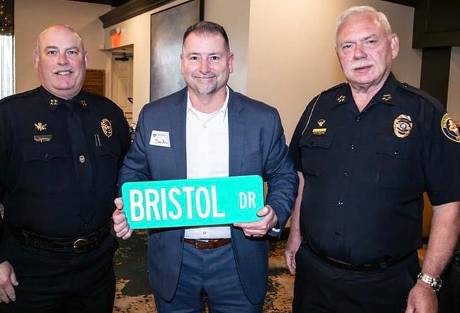Hendersonville Police Chief Mickey Miller, from left; Dan Bristol, Spencer Bristol's father; and Assistant Chief Jim Jones.