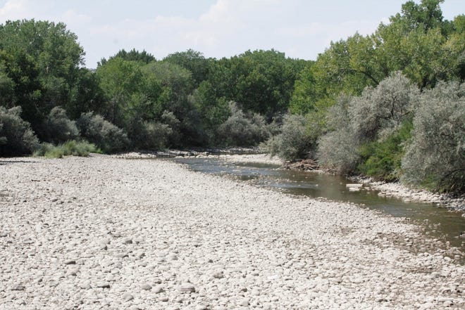 The Animas River, which has been running a 7 % of its normal flow, is pictured, Thursday, Aug. 27, 2020, in Farmington.