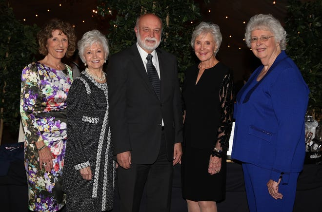 Bonnie Timarac, Bobbie Reiman, Dr. Richard Hart, Dr. Jane Woolley and Joyce Engel share a smile at the Woolley-Pettis endowment dinner in 2015.