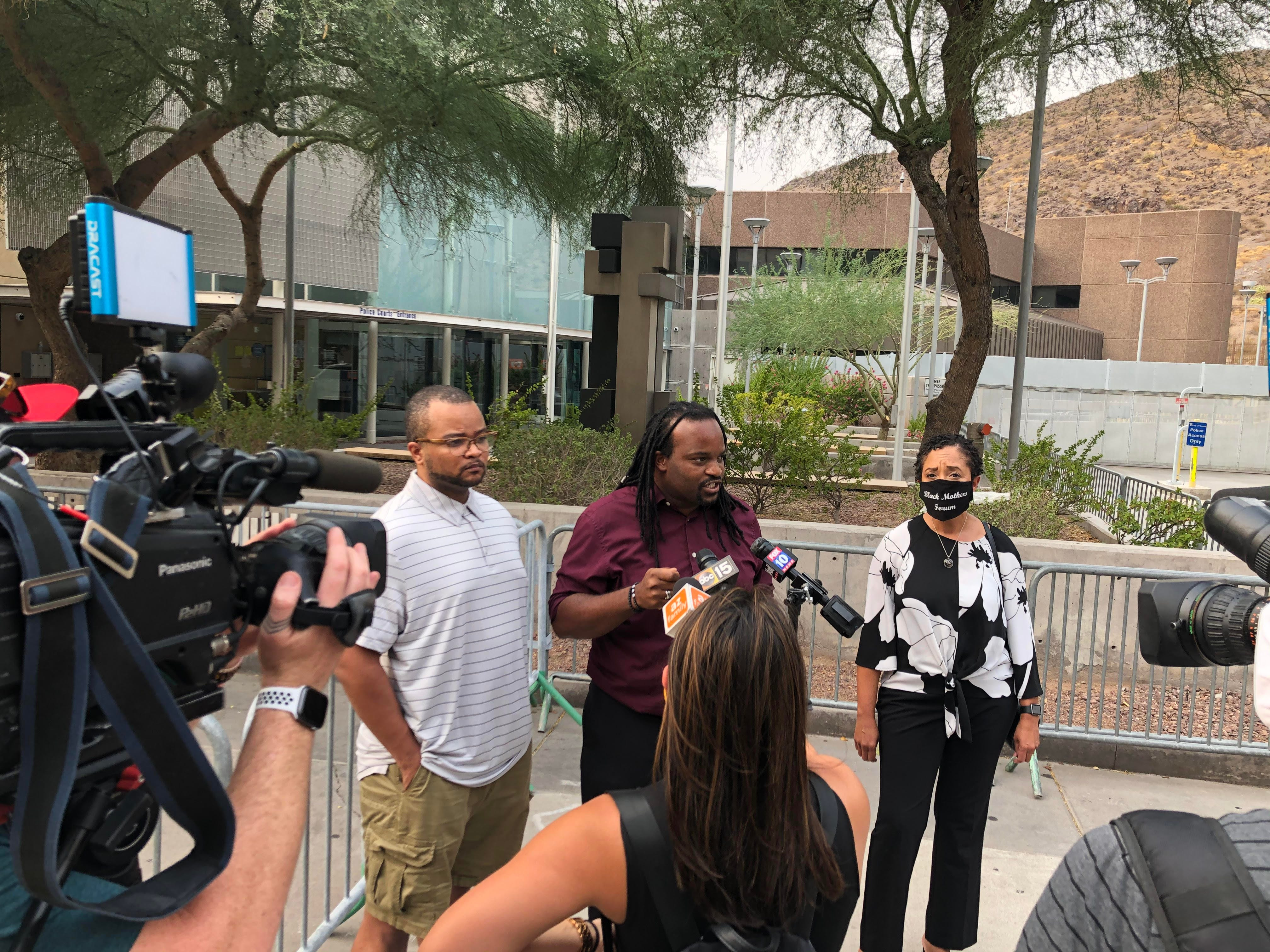 Kenneth Smith with Unity Collective, Janelle Wood with Black Mother's Forum, and Jacob Raiford with the W.E. Rising Project call for the firing of a Tempe police officer accused of holding an unarmed black man at gunpoint during a media briefing on Sept. 8, 2020.