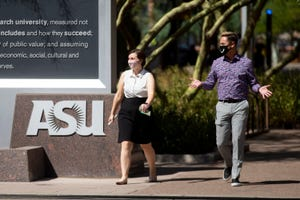 Arizona State University students walk through Taylor mall at the school's downtown Phoenix campus on Sept. 9, 2020.