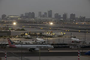 Haze is seen across downtown Phoenix from the California wildfires as night falls as seen from Phoenix Sky Harbor International Airport on Sept. 8, 2020.