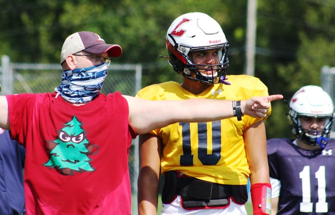 Lebanon High assistant coach Karl Liedtka and quarterback Isaiah Rodriguez work on a play during a recent practice. Rodriguez is closing in on 5000 career passing yards and could reach the mark in this week's home game vs. Garden Spot.