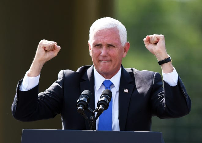 Vice President Mike Pence pumps his fists as he steps to the microphone during a campaign stop in New Sewickley Township Thursday.