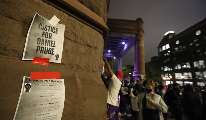Black Lives Matter protesters plaster 'Justice For Daniel Prude' all around City Hall during a night of peaceful protests Tuesday, Sept. 8, 2020 in Rochester.