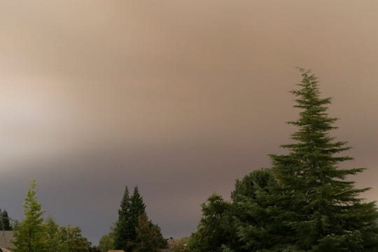 A thick, smoky haze obscures the sun from north Redding on Wednesday morning, Sept. 9, 2020, due to Northern California wildfires.