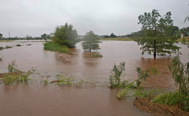 The Red Arroyo floods its banks at the San Angelo City Park near Sul Ross St. on Wednesday, Sept. 9, 2020.