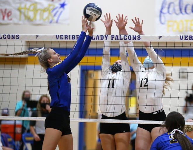 Veribest's Bella Halfmann goes for a kill as Water Valley's Kynlea Foltz, center, and Kalysta Minton-Holland try to block it during a District 7-2A volleyball match at the Veribest High School gym on Tuesday, Sept. 8, 2020. Veribest won in four sets.