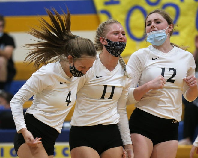 Water Valley's, from left to right, Kyrie Shields, Kylea Foltz and Kalysta Minton-Holland get fired up after winning a point against Veribest during a District 7-2A volleyball match at the Veribest High School gym on Tuesday, Sept. 8, 2020.