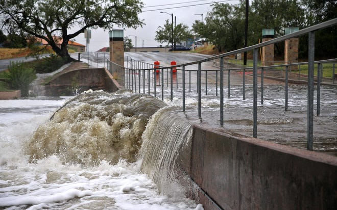 The Concho River spills over the Irving Street bridge near downtown San Angelo on Wednesday, Sept. 9, 2020.