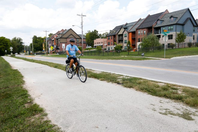 A cyclist uses the Galloway Creek Greenway Trail on Wednesday, Sept. 9, 2020.