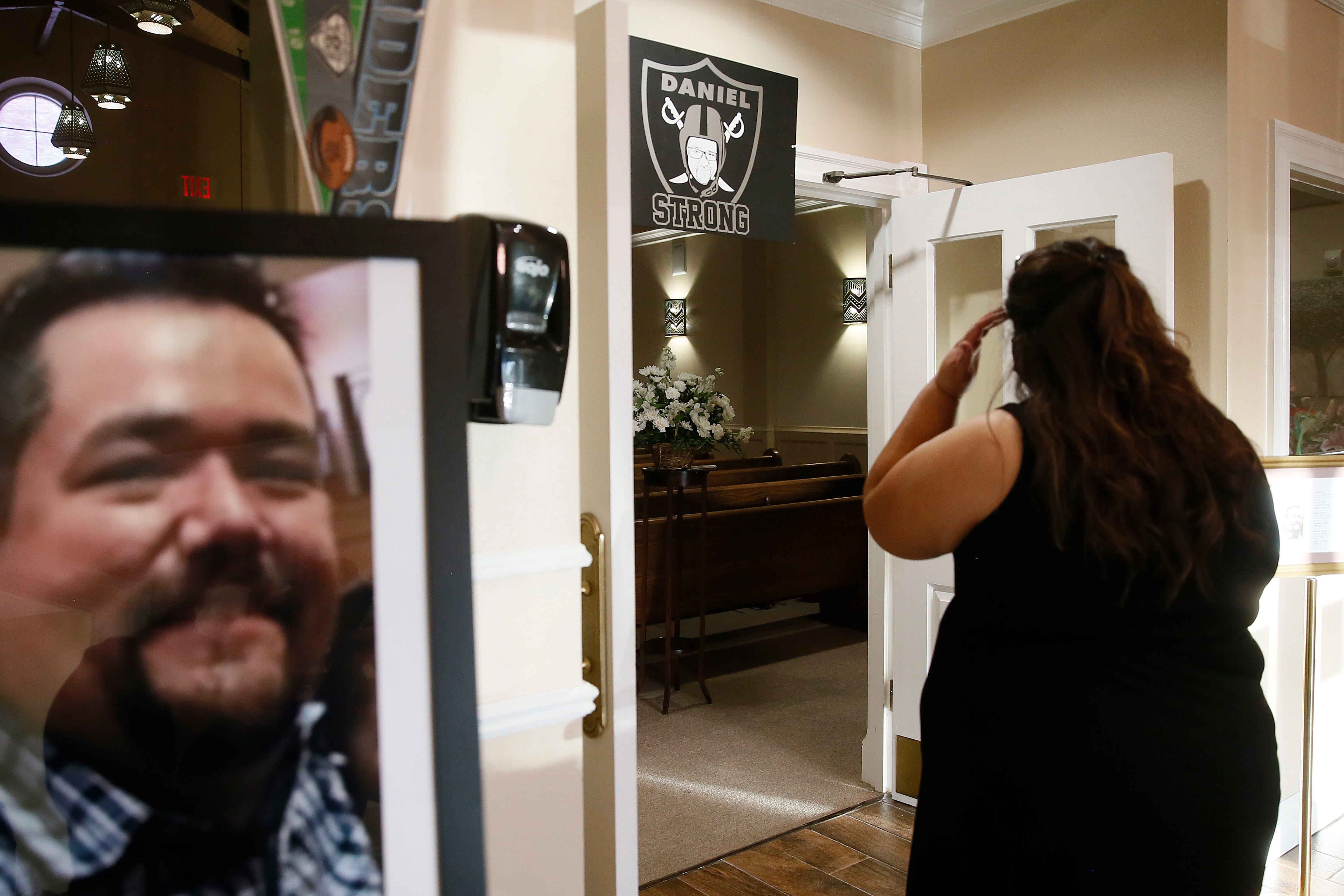 Erika Castor-Morales prepares to enter the prayer services for her husband Daniel Morales during his Celebration of Life on Aug. 12, 2020, at Martin Funeral Home in El Paso.