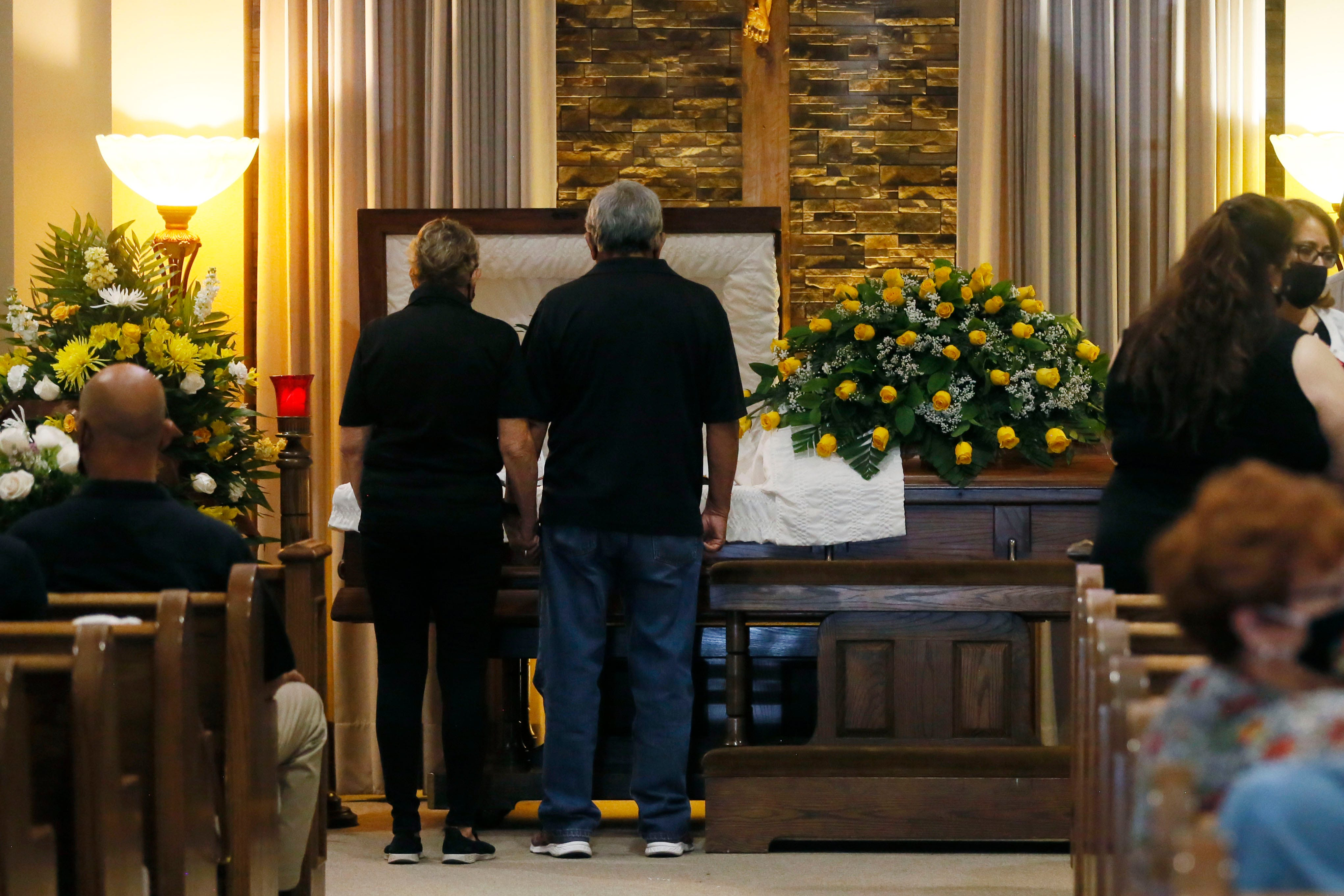 A couple pays their respects during Daniel Morales' Celebration of Life on Aug. 12, 2020, at Martin Funeral Home in El Paso.