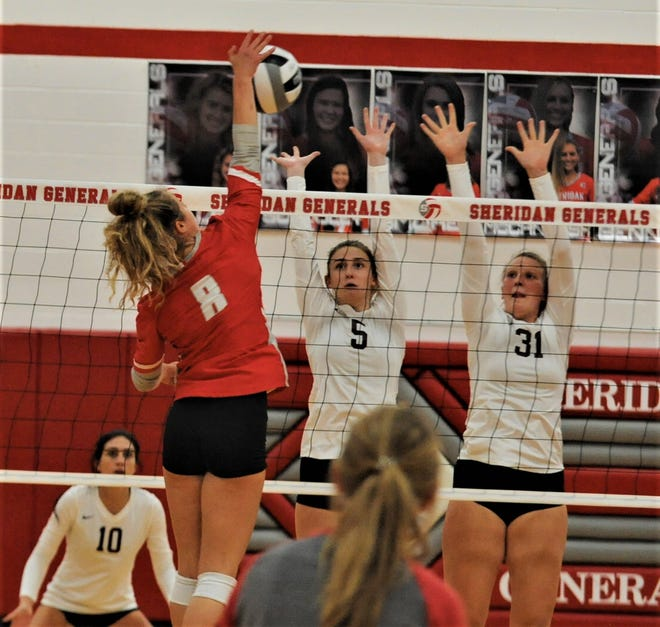 Sheridan's Brooklyn Heller hits the ball against John Glenn's Shelby Zamensky (5) and Hannah DeMattio (31) in Tuesday's match. The Generals won in four sets.