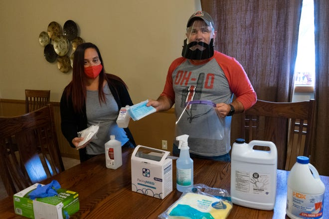 Brandi Brown and Marty Gamble display the personal protection equipment The Carr Center is prepared with to welcome back clients.