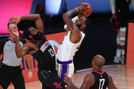 LeBron James, center, and the Los Angeles Lakers got the better James Harden (13) and the Houston Rockets in Game 3.