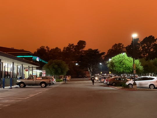 On Wednesday, September 9, 2020, at 11:15 am, in the parking lot of the Safeway supermarket near San Francisco's Diamond Heights. The orange-red sky was caused by multiple wildfires in the area.
