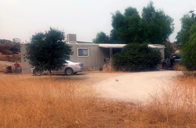 A car is left parked at a house where killings occurred in the rural town Aguanga, Calif., Tuesday, Sept. 8, 2020. Seven people were found fatally shot at an illegal marijuana growing operation in Aguanga. The crime scene was discovered before dawn Monday, Sept. 7, after deputies responded to a report of an assault with a deadly weapon at a home in the unincorporated community of Aguanga, north of San Diego, the Riverside County Sheriff's Department said in a statement.