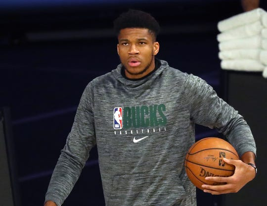 Giannis Antetokounmpo sat out Game 5 with an ankle injury, and the Bucks were eliminated from the playoffs by the Heat.