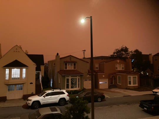 At 11:17 a.m. in San Francisco on Wednesday, street and house lights were on as smoke from fires burning throughout California darkened the skies.