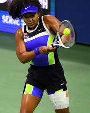 Naomi Osaka advanced to the U.S. Open semifinals by beating Shelby Rogers in straight sets.