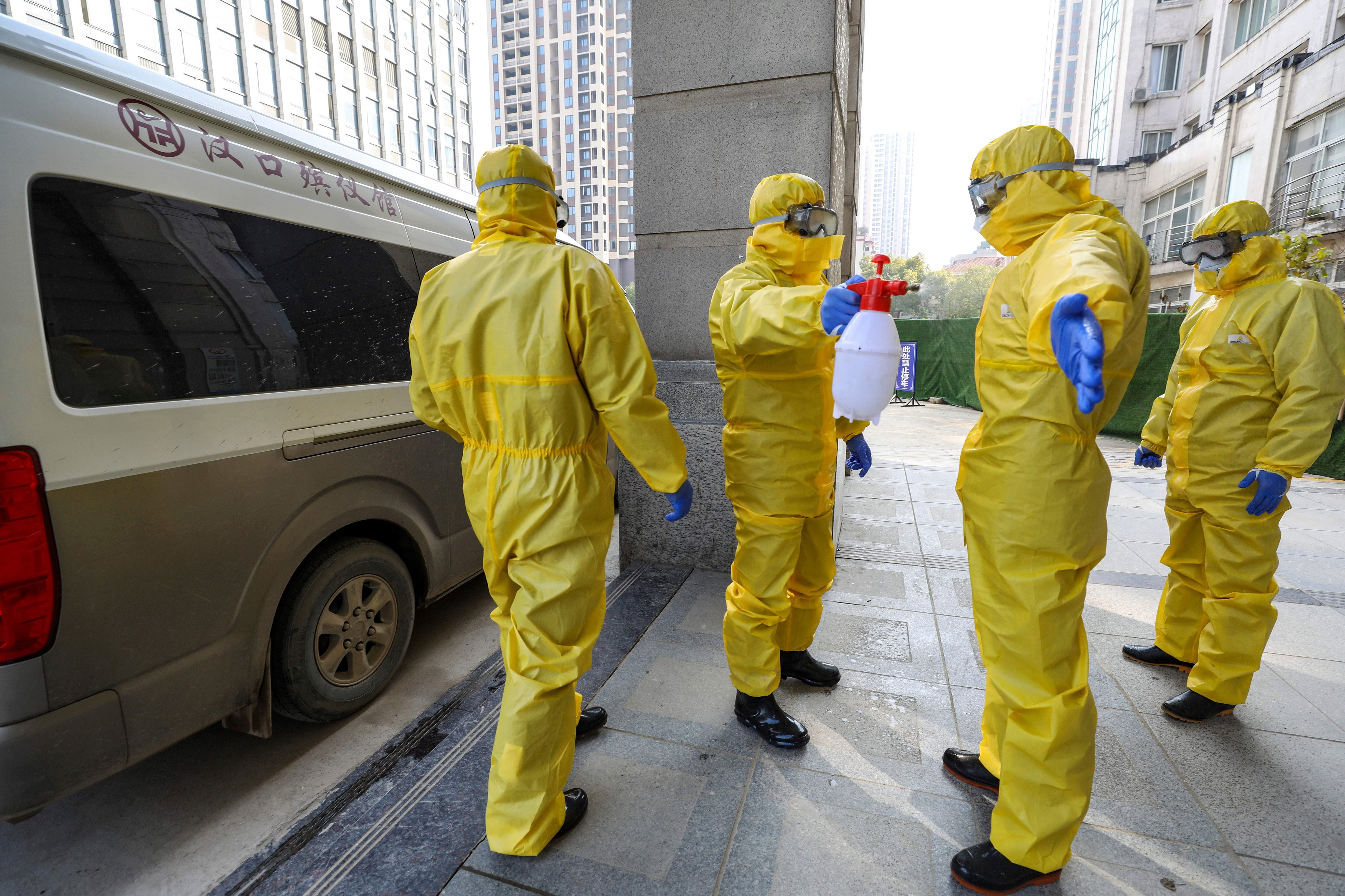 Funeral workers disinfect themselves after handling a virus victim in Wuhan in central China's Hubei Province.