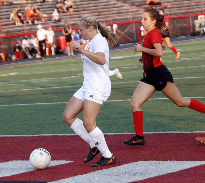 Marlington's Gracie Henry, scored a goal as Minerva's Avrielle McGrew defends during conference action at Minerva High School Wednesday, September 9, 2020.