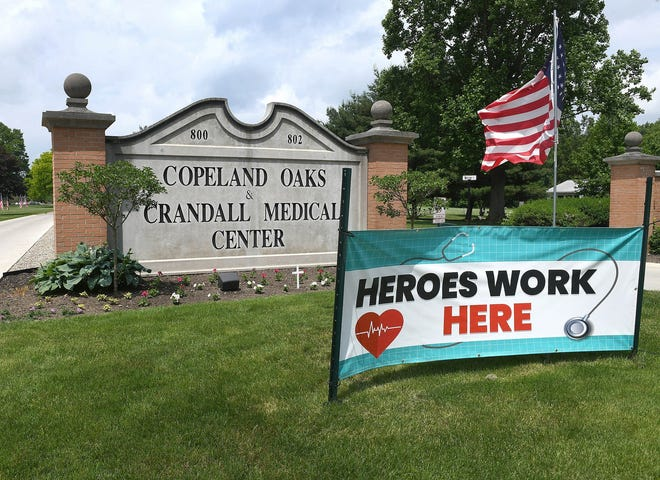The main entrance to Copeland Oaks and its Crandall Medical Center, in June 2020.