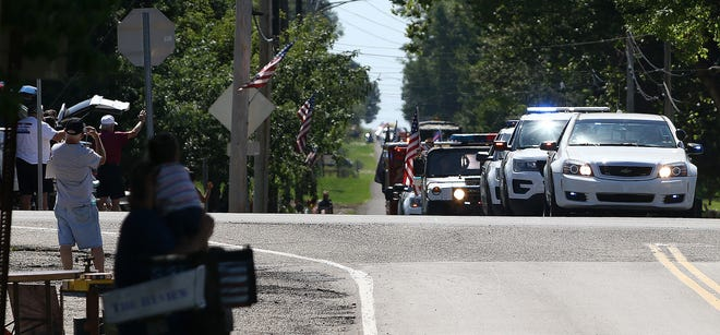 "Vehicles parade north on Marlboro Avenue during the ""Marlboro Appreciation Parade,"" which wove through the township Saturday. The event featured Marlboro Townships safety service workers and their vehicles, along with township officials. The parade also included some township residents, who were invited to join."