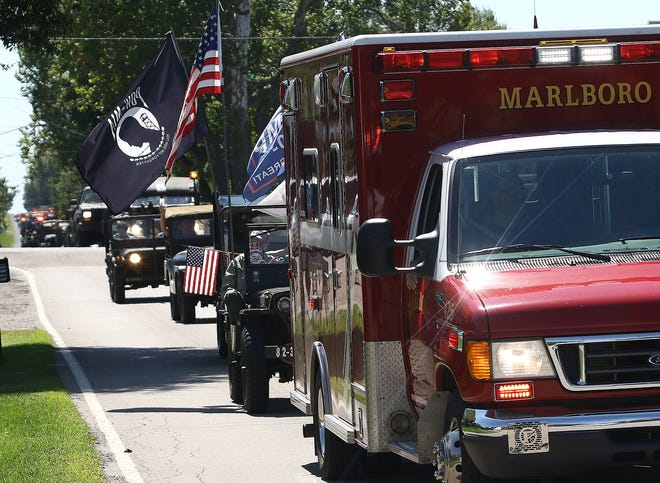 "A Marlboro Township Volunteer Fire Co. ambulance parades north on Marlboro Avenue during Saturday's ""Marlboro Appreciation Parade."" The event was planned as a salute to the township's residents."