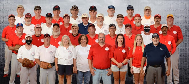 Pictured in the bottom row left to right are John Maiken (CEO), Erv Howard (COO), Donna Rae Maiken (Scorekeeper/Secretary), Diane Steiner (sub-scorekeeper), Tim Hershey (Umpire/Pressbox), ChloeHalblaub(Press box), Casse Beer (Press box) and Barry Pringle (Player/Umpire). In the second row are Rick Goss, Jeff Haldeman, Bob Andress,BobHalblaub, Gary Marshall, Rich Hess, Dan Chronister, Ron Motil and Larry Coombs. In the third row are Chuck Henley, Jr., Greg Perry, DougCellar, Dave Barr, Jim Reed, Doug Culler, Dennis Edwards, Jeff Pryor, Gene Pence and Terry Chronister. In the back row are Vern Vore, Don Beecher, Jim House, Bill Shilling, WayneBloodhart, John Slabach,Kent Snyder and Lorin Martin. Members not pictured are Rick Bowerize, Dave Iceman (IL), Sam Rogers, Gary Wittman, Glen Wittman,John Barkerand Janet House (Press box).