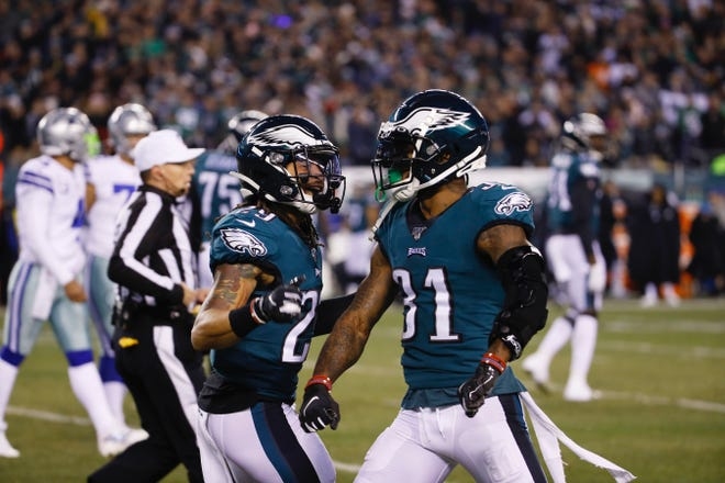 The Eagles' Avonte Maddox, left, and Jalen Mills are capable of playing safety and cornerback.