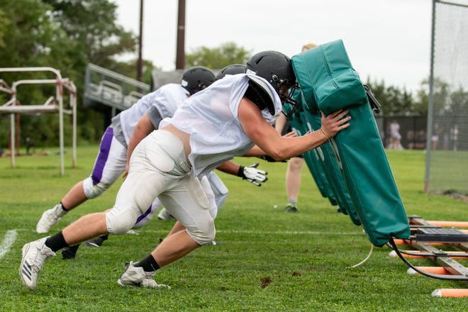 Palisades linemen practice in preparation for the start of the football season, which begins Friday night for the Pirates.