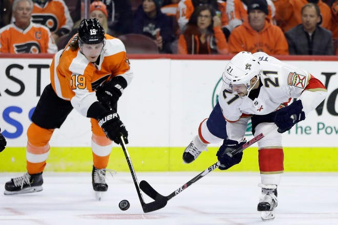 The Flyers' Nolan Patrick, left, and  Panthers' Vincent Trocheck battle for the puck.