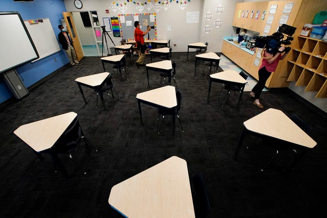 Media members document the inside of a fifth grade classroom set up for social distancing during a media demonstration at A.J. Whittenberg Elementary School of Engineering on July 20 in Greenville.
