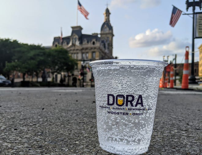 Downtown patrons who wish to enjoy an alcoholic beverage within the Designated Outdoor Refreshment Area must have the drink poured into an official DORA cup. Servers must sign the cups with that day's date.