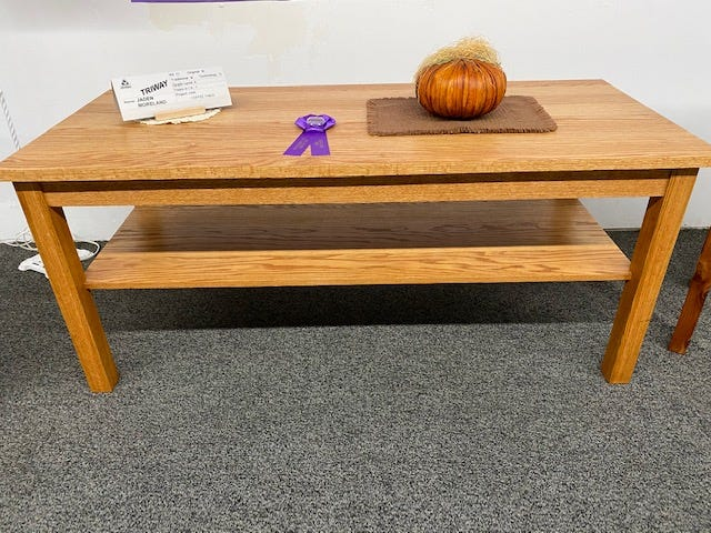 Freshman Jaden Moreland of Triway High School won Best of Show Industrial Arts Award with this oak coffee table.