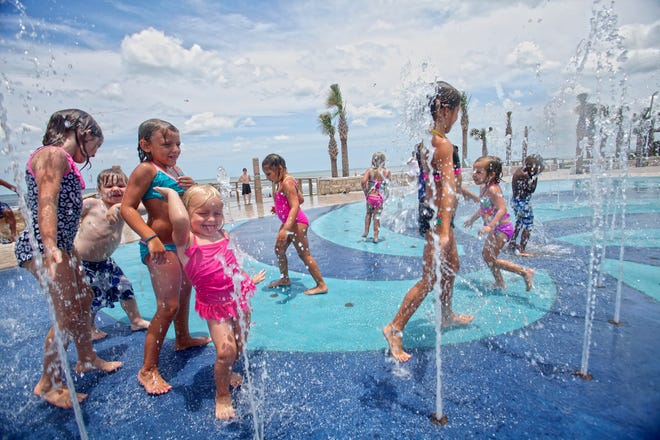Children playing in the splash pad at Andy Romano Park in Ormond Beach. A $2.9 million Volusia ECHO grant helped make the park possible.