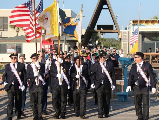 Members of the Knights of Columbus Council 10514 Color Guard lead a large crowd onto the Flagler Beach Pier in 2019 to commemorate the victims of the terrorist attacks on Sept. 11, 2001.