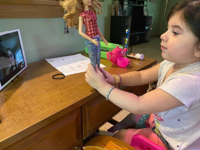 Kylie Garcia, 3, at home in Palm Coast, where she participates in online speech therapy sessions.